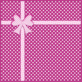 Bow and ribbon on purple polka dot background — Stock Photo