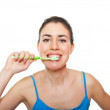 Cute and happy woman brushing her teeth — Stock Photo #10252781