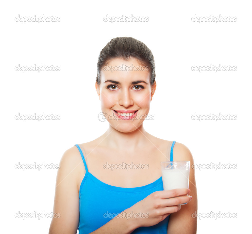 Portrait of a beautiful young adult holding glass of milk isolated on whitw  Stock Photo #10252907