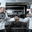 Portrait of two chefs fighting — Stock Photo #8103594