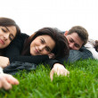 Stock Photo: Young relaxing and lying on the grass