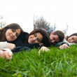Young relaxing and lying on the grass — Stock Photo #8103956