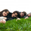 Young relaxing and lying on the grass — Stock Photo #8103960