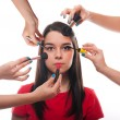 Beautiful young female getting her make-up done — Stock Photo