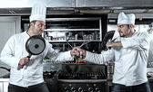 Portrait of two chefs fighting — Stock Photo