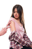 Beautiful young female getting vaccination — Stock Photo