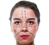 Beautiful young female with a face marked for plastic surgery — Stock Photo