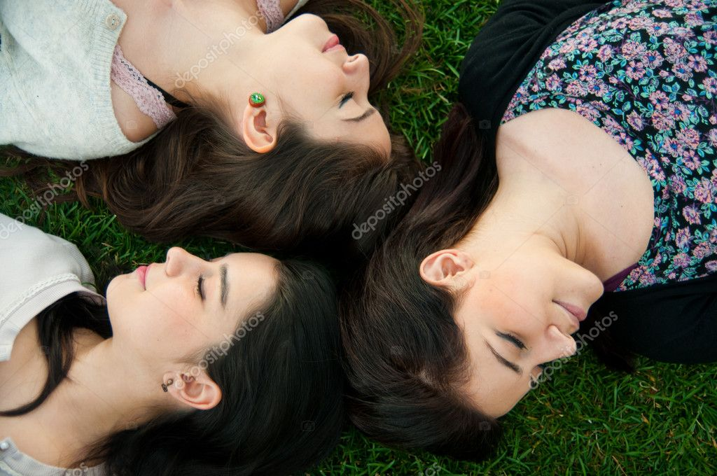 Group of young relaxing and lying on the grass — Stock Photo #8104042