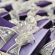Stock Photo: Purple boxes with white ribbon.