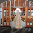 Wedding Dress Hanging Up in a Church — Stockfoto