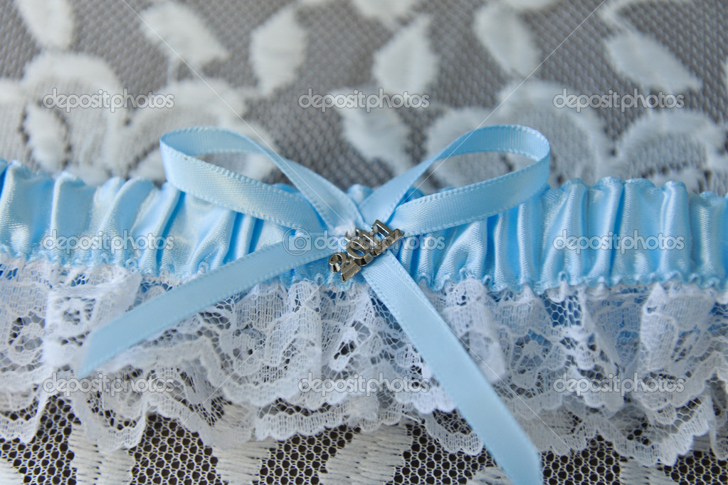 Wedding garter for a bride on her wedding day — Stock Photo #9229374