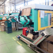 Stock Photo: Injection molding machines in large factory