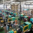 Постер, плакат: Injection molding machines in a large factory