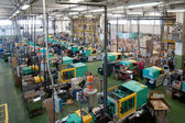 Injection molding machines in a large factory — Stock Photo