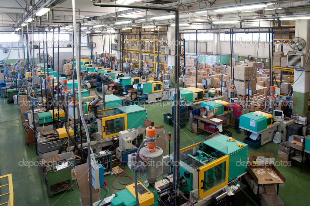 Injection molding machines in a large factory — Stock ...