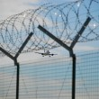 Stock Photo: Airplane landing, wire barbed