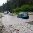 Car crossing a road flooded — Stock Photo #9939147