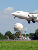 Airplane and radar — Stock Photo