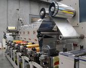 Industrial printshop: Flexo press printing — Stock Photo