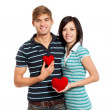 Young love couple holding red heart — Stock Photo #8676351