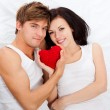 Young love couple in bed — Stock Photo