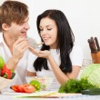 Young couple in kitchen — Stock Photo #9830577