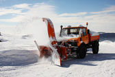 Snow Thrower at work — Stock Photo