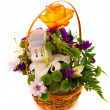 Stock Photo: Flowers in a basket and gold earrings. isolated.