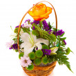 Stock Photo: Bouquet flowers in a basket , isolated.