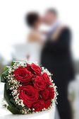 Newly-married couple and wedding bouquet. — Stock Photo