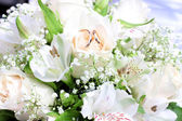 Wedding bouquet about wedding rings — Stock Photo