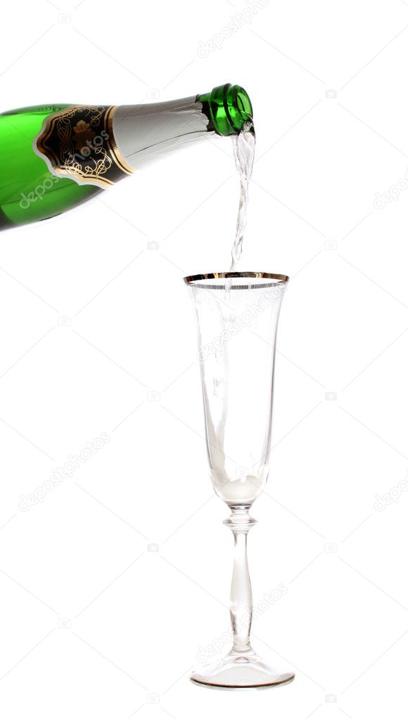 Champagne flows from a bottle in a glass, is isolated. — Stock Photo #10201347
