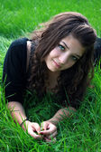 Teenager on a green grass. — Stock Photo