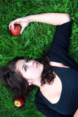 Girl-teenager about apples. — Stock Photo