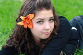 Girl about a flower. — Stock Photo