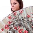 Royalty-Free Stock Photo: Teenager with a Japanese fan,isolated.