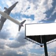 Billboard and airplane — Stock Photo