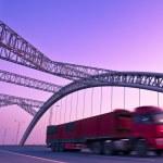Truck speeding through a bridge at sunset,motion blur. — Stock Photo