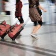 Bags at the airport, motion blur — Stock Photo