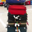 Bags at the airport, motion blur — Stock Photo #9475219