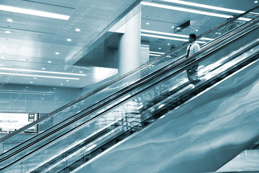 The escalator of the airport.  Stock Photo #9475126