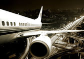 The airplane take off from the city night. — Stock Photo