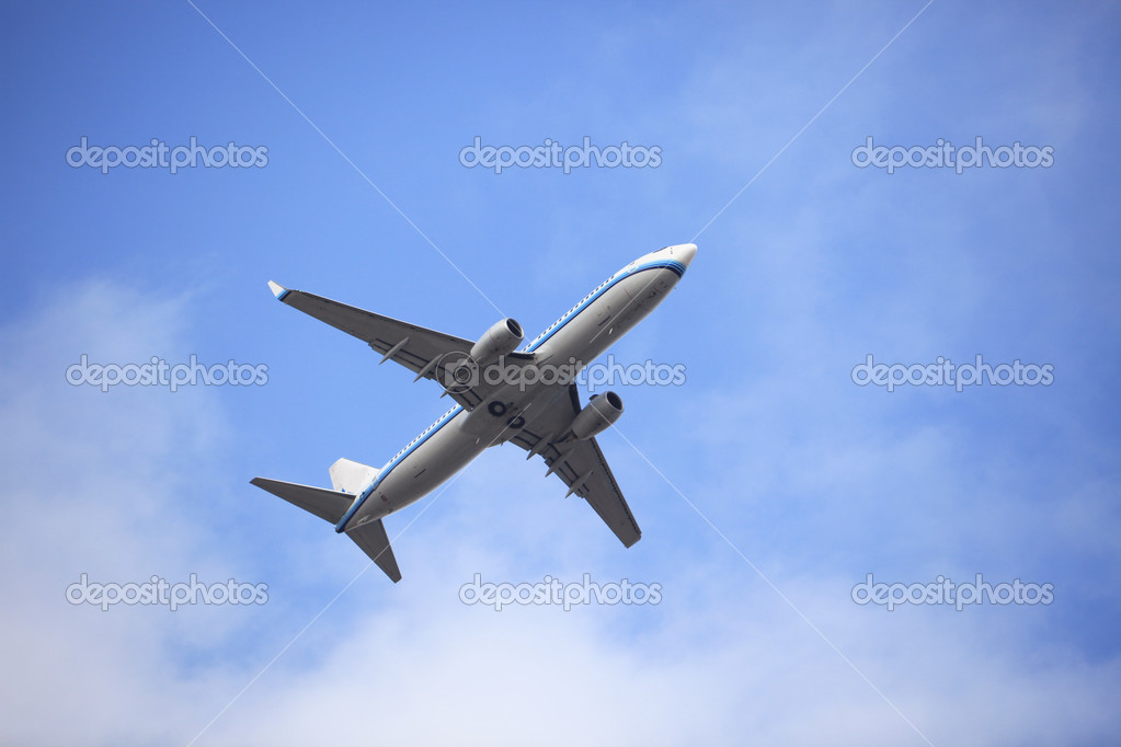The airplane on  the blue sky background.  Stock Photo #9523438