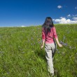 Stock Photo: Girl walking outdoor of meadow.