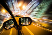 Car on the road wiht motion blur background in night. — Stock Photo