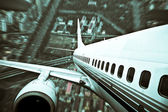 The airplane away from the city,abstract background — Foto Stock