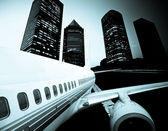 The airplane away from the city,abstract background — Stock Photo
