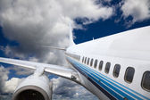 The airplane with the blue sky background. — Stock Photo