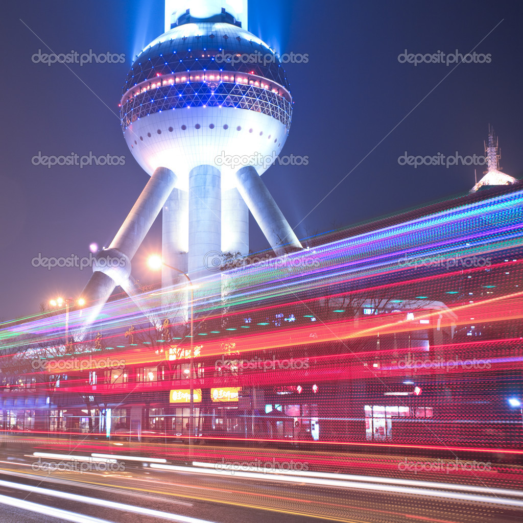 The light trails on the modern building background in shanghai china. — Stock Photo #9650164