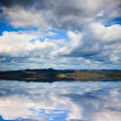 The background of the cloud and its reflection image in the water. — Stock Photo